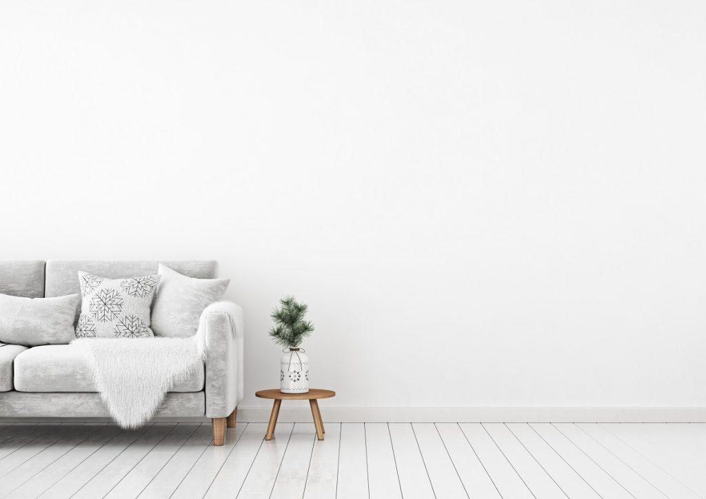 Dirty white sofa beside a vase