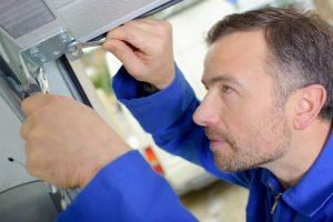 repairman fixing the garage door