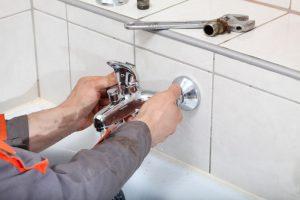 plumber checking a water tap