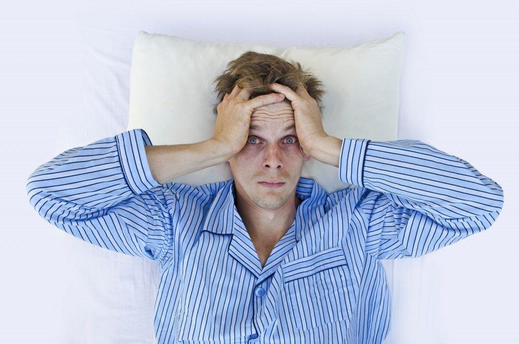 Man having a hard time sleeping