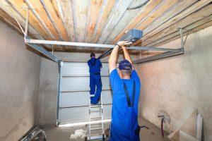 Repairmen fixing a garage door