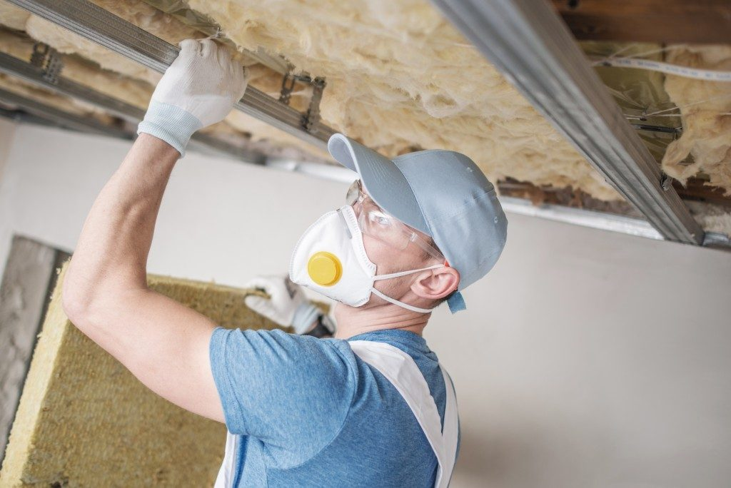 Man checking the insulation