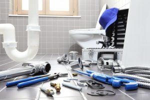 Plumber tools and equipments in a bathroom