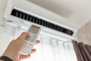 Person adjusting the AC temperature