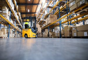 spacious warehouse with a forklift operating