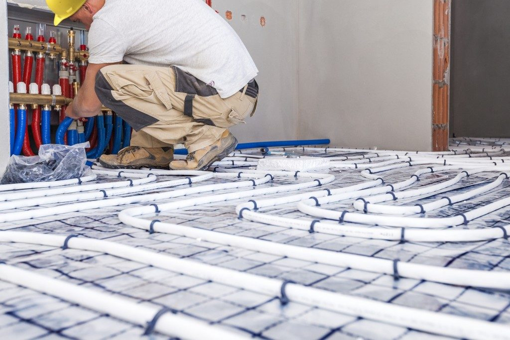 Man Installing Floor Heating Materials