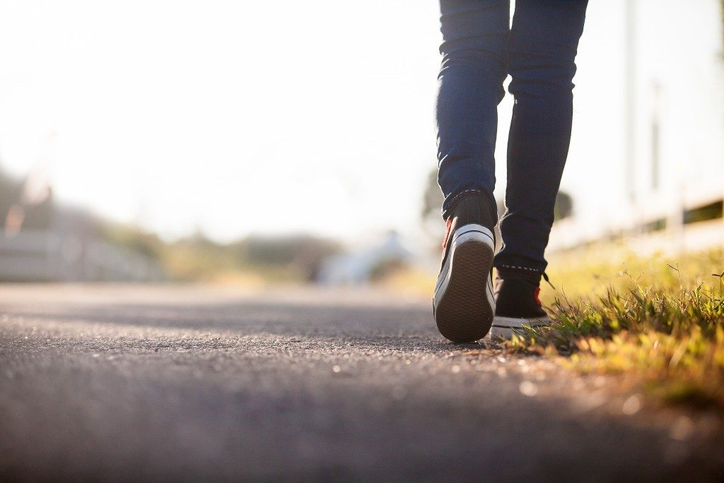 Walking asphalt road
