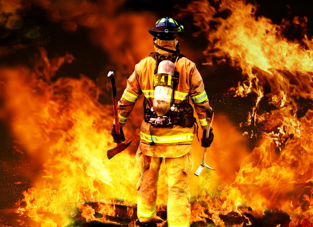 fireman in front of a raging fire