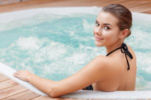 Woman relaxing on a hot tub