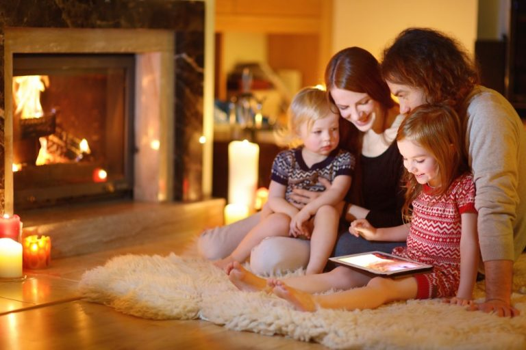 Family in living room with fireplace