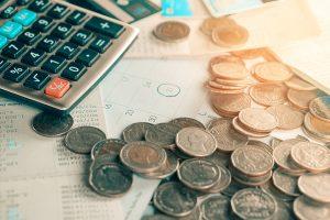 Calculator, coins and bills