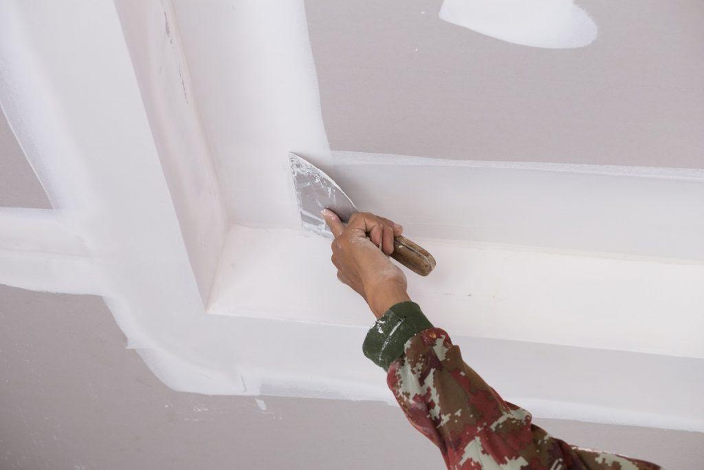 Worker doing drywall repair