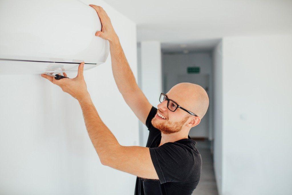 Man checking AC