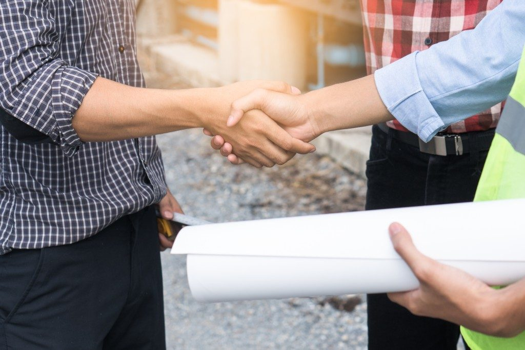 Architect shaking hands with a client