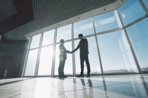 Businessmen shaking hands in a building