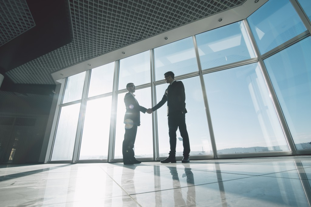 Businessmen shaking hands in a building