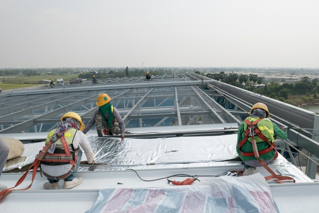 construction workers installing roof