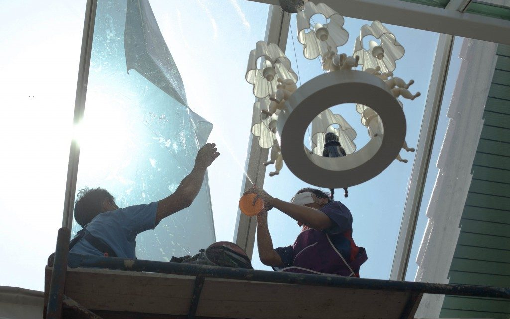 wrappers tinting a glass house window