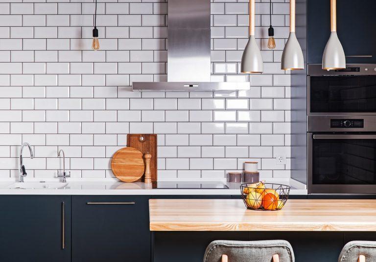 modern kitchen sink with white tiles
