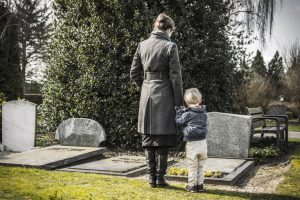 mother and child at the cemetery