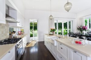 stylish white kitchen with cream countertops