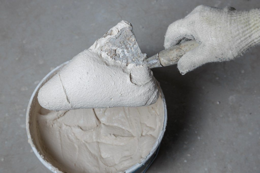 Mixing a small batch of concrete to repair a cracked column