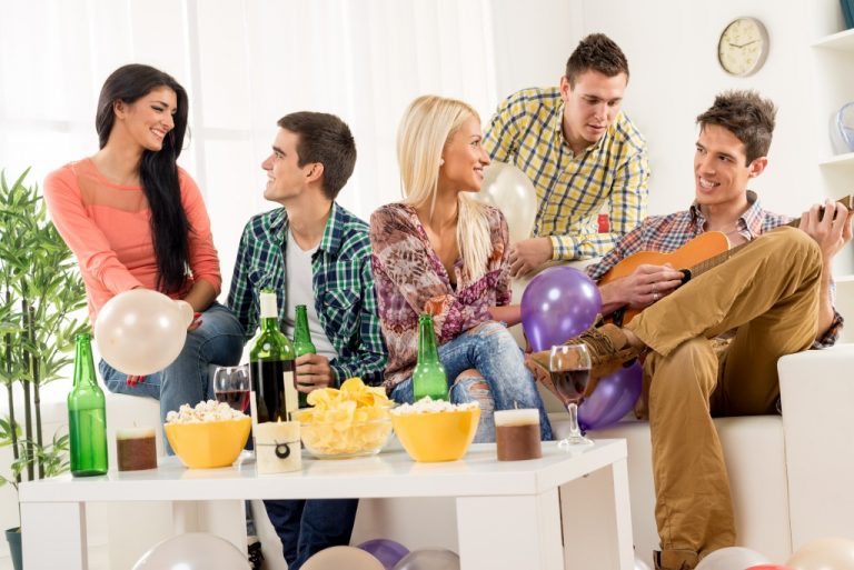 Group of people hanging out inside a home