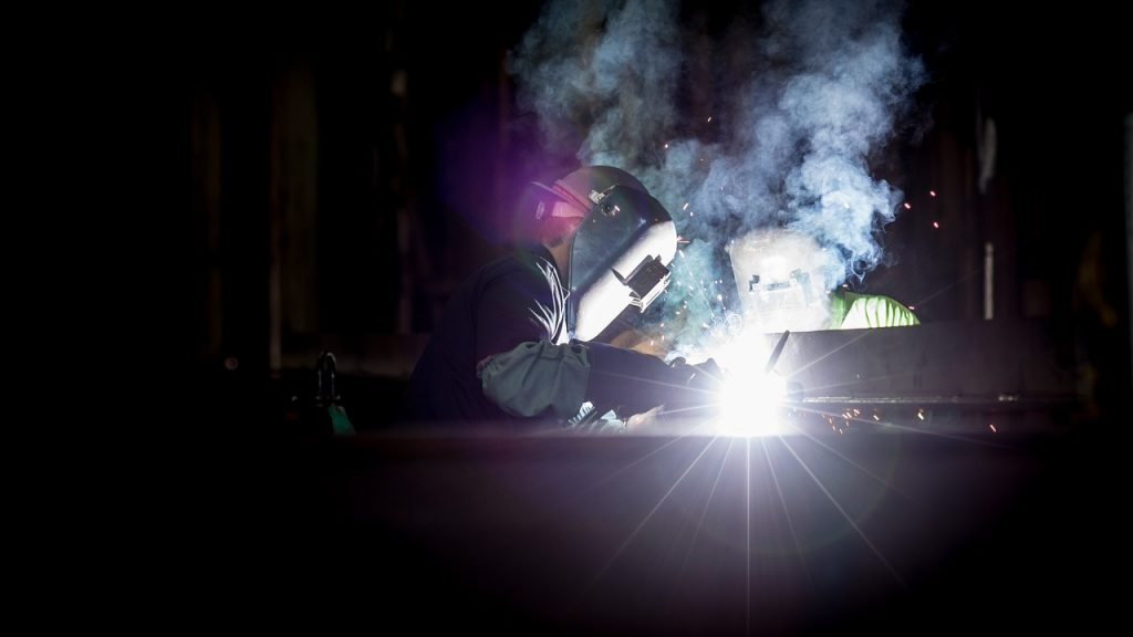 Man wearing safety gear while welding