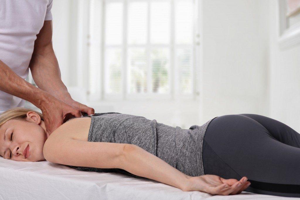 Woman having a deep tissue massage