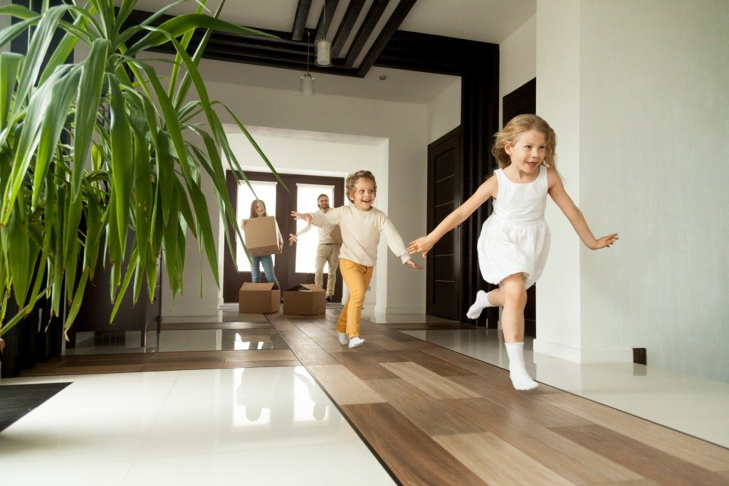Kids running in their new house