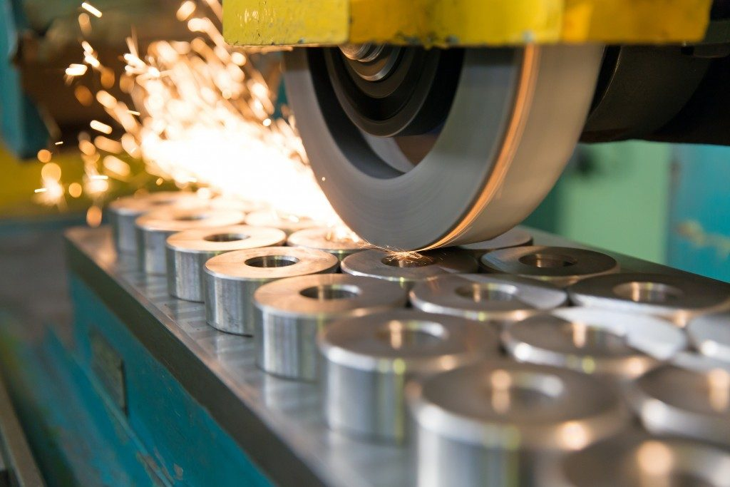 finishing metal working on horizontal surface grinder machine with flying sparks