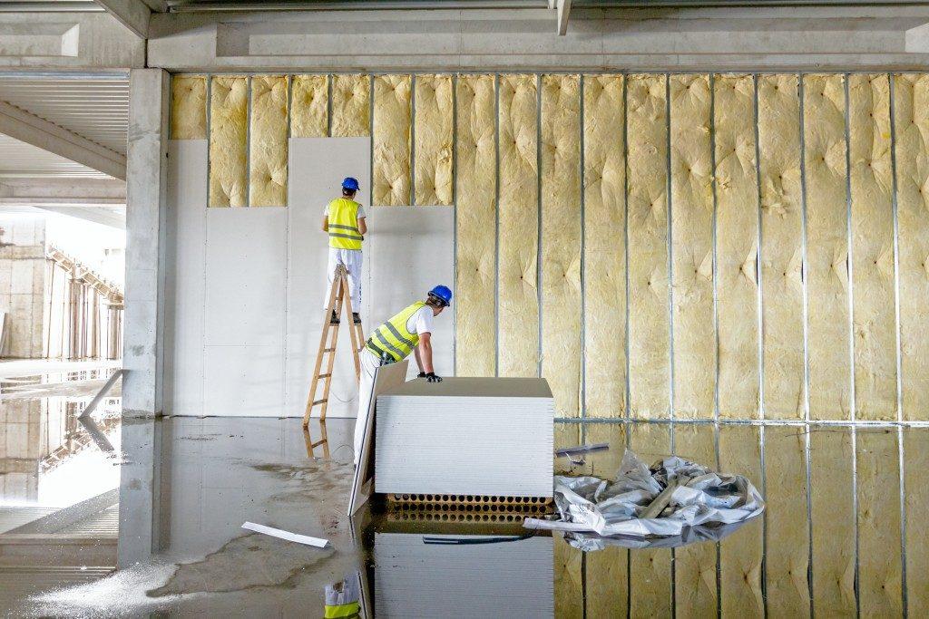 men applying wall paper