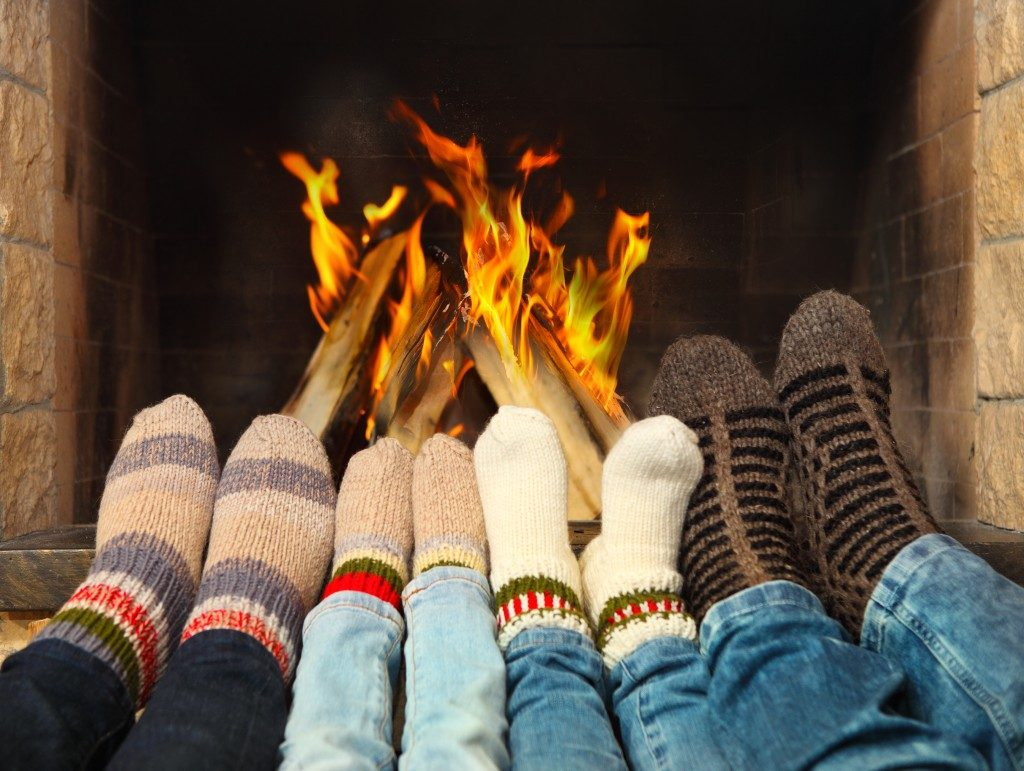 feet wearing socks in the fire