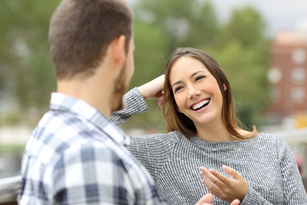 woman and man talking