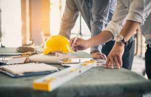 contractors drafting a blueprint