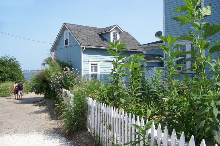 blue-house-with-picket-fence