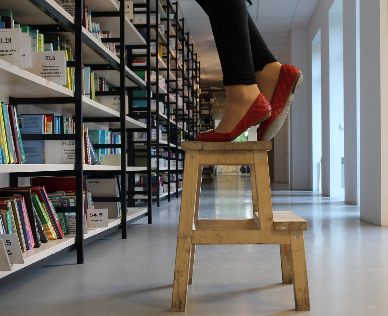 woman-stepping-on-wooden-stepping-stool