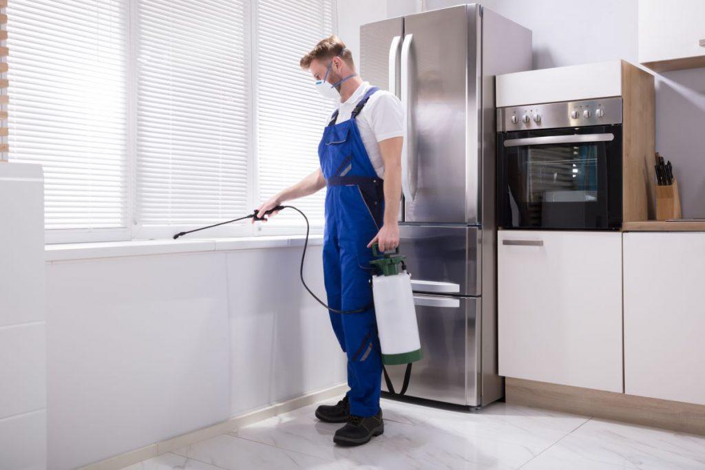 man disinfecting