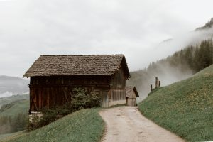 a wooden house on the mountain side