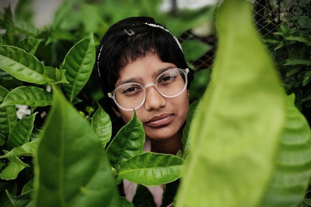 woman amongst some plants
